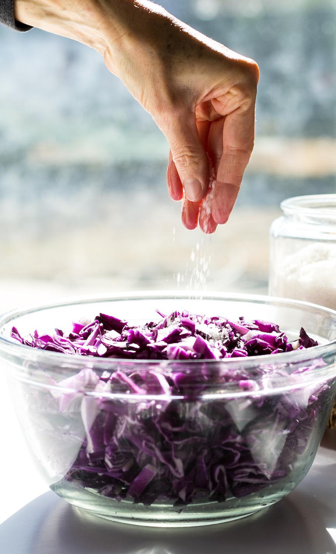 Sprinkling Salt Over Red Cabbage